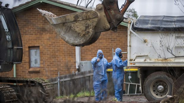 Workers demolish a Mr Fluffy home in Woden Valley, ACT, in 2014.