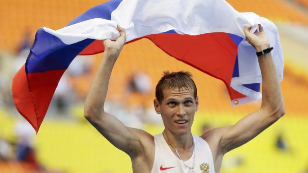 Russia's Mikhail Ryzhov celebrates winning silver in the men's 50km walk at the World Athletics Championships in Moscow ...