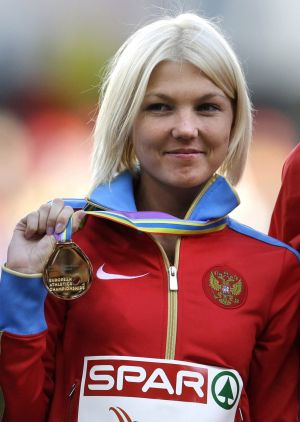 Elmira Alembekova shows the gold medal she won in the 20km walk at the European Championships in Zurich in 2014.