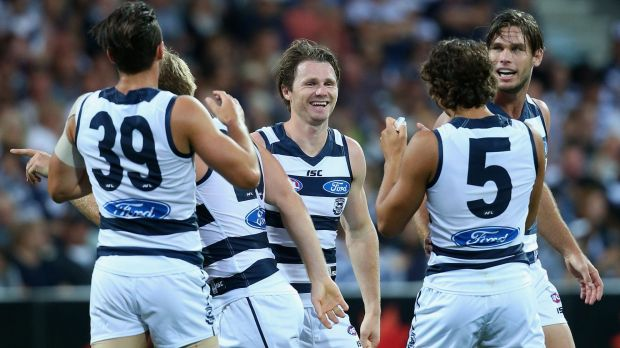 Well done: Patrick Dangerfield is congratulated by teammates after kicking a goal.