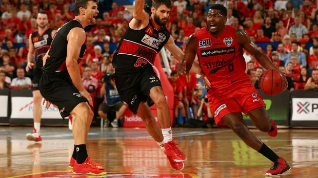 On the money: Wildcats import Jermaine Beal drives to the basket against the Hawks during the NBL semi-final win over ...