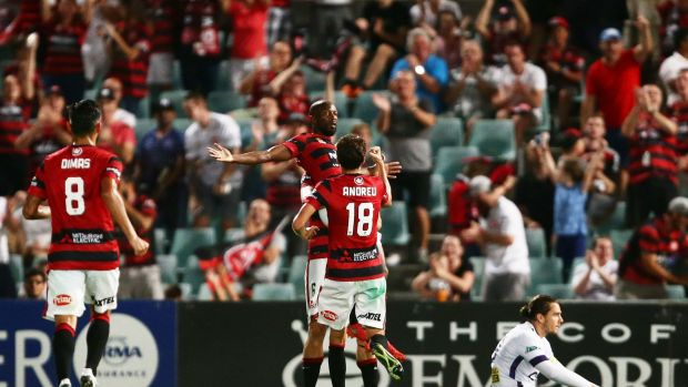 On a roll:  Romeo Castelen celebrates after scoring against Perth.