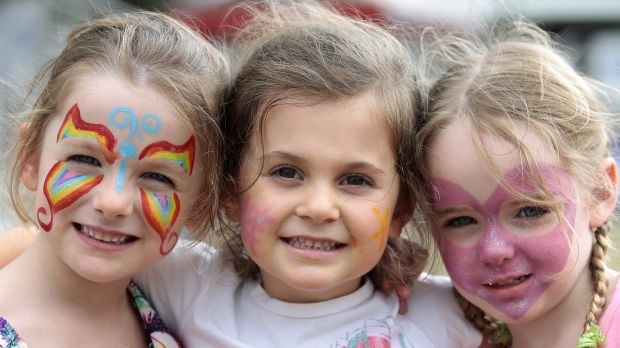 From left, Chloe Heycox, of Harrison, Lucinda Ovin, of Casey, and Zarah Heycox, of Harrison, each 4, had their faces ...