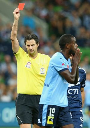 Jacques Faty of Sydney FC is given a red card.