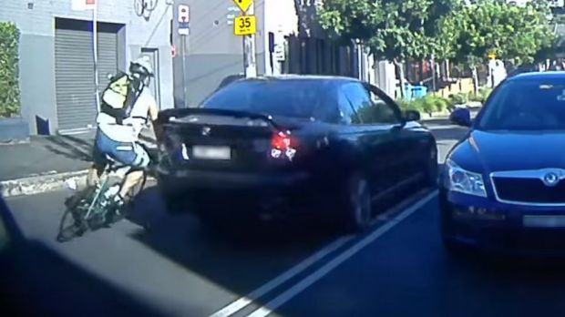 A frame grab from a video of the collision between Ray Kan's bike and a car on Bridge Road, Glebe.