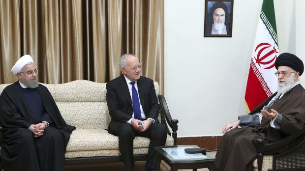 Supreme Leader Ayatollah Ali Khamenei, right, speaks with Swiss President Johann Schneider, centre, as Iranian President ...