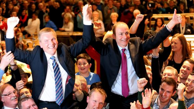 Fianna Fail Leader Micheal Martin, right, celebrates with supporters at City Hall in Cork.