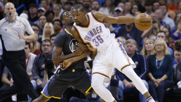 Upgrade: Kevin Durant takes on Harrison Barnes. Durant will join the Warriors forward line.