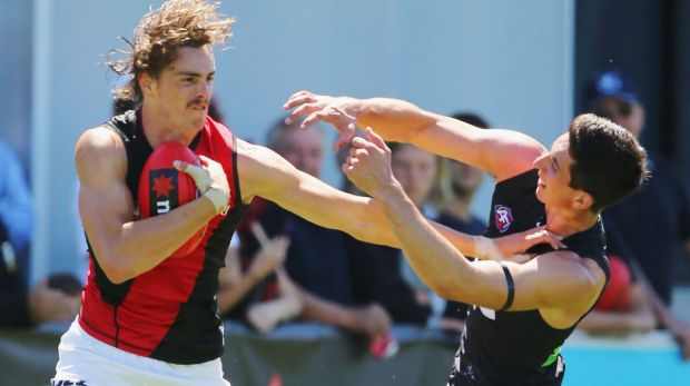 Welcome to the big time: Joe Daniher fends off No.1 draft pick Jacob Weitering.