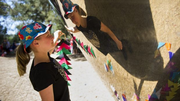 Lily Harvey, 12, of Wagga Wagga, spies her reflection at the National Gallery's Sculpture Garden Sunday event.