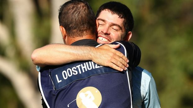 Louis Oosthuizen celebrates winning the Perth International with his caddy.