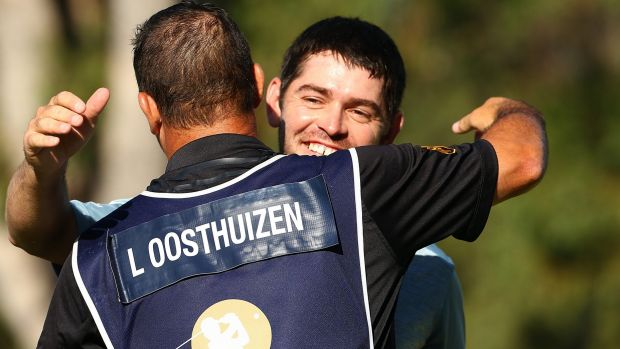 Good win: Louis Oosthuizen of South Africa embraces his caddie Wynard Stander after his success.