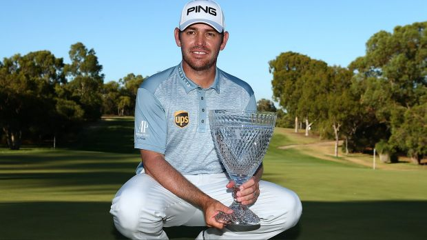 Off to Miami: Louis Oosthuizen of South Africa poses with the trophy in Perth.