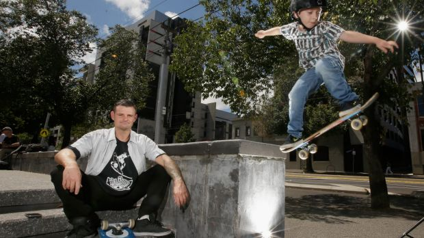 Tas Pappas and his six-year-old son Billyat Lincoln Square in Carlton.