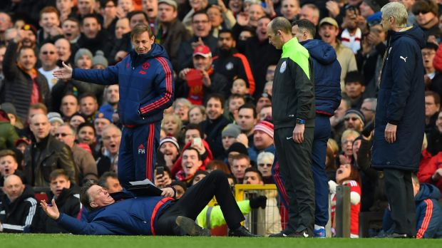 Free-fall: Manchester United and coach Louis van Gaal are  falling fast down the ladder.