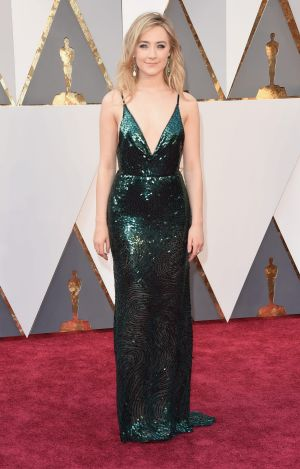 Saoirse Ronan, best actress nominee for her role in Brooklyn, wore custom Calvin Klein emerald green in a nod to her ...