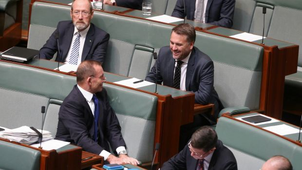 Former prime minister Tony Abbott and Liberal MP Jamie Briggs in discussion during question time on Monday.