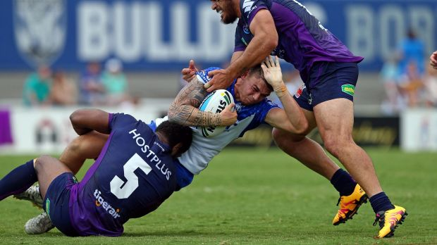 Opportunity: Brad Abbey is tackled by Marika Koroibete and Tohu Harris during the NRL trial between the Canterbury ...