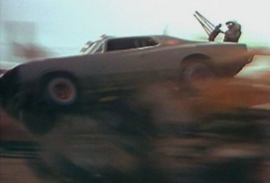 Max Aspin doubled for Mel Gibson in the 1981 film. Here, he crashes a modified Valiant Regal in a stunt that did not go ...