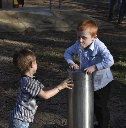 Halina Steele - A friend turning the water on to allow my great-nephew, Travis, to drink from a bubbler in Telopea Park ...