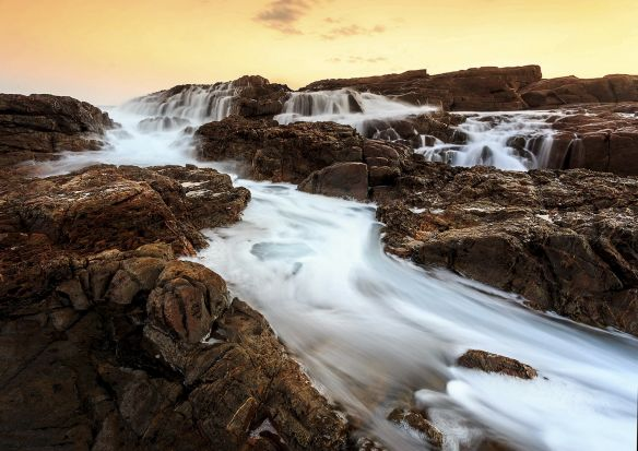 Chad Clark - Ocean falls. Wave generated waterfalls during the holidays at Mystery Bay on the South NSW coast.