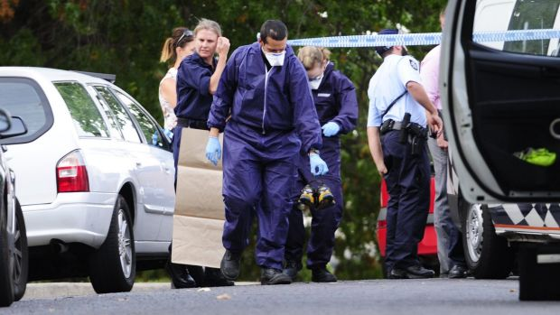Police investigate the suspicious death at the Stuart Flats in Griffith on Monday.