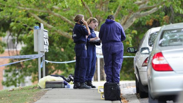 Police investigating the suspicious death at the Stuart Flats in Griffith on Monday.