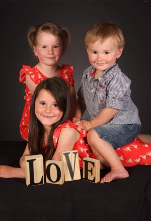 Ayla, 5, and Bria, 7, and Leland 2 in one of the photos ordered in a package from Littler Masterpiece Studio Pty Ltd.