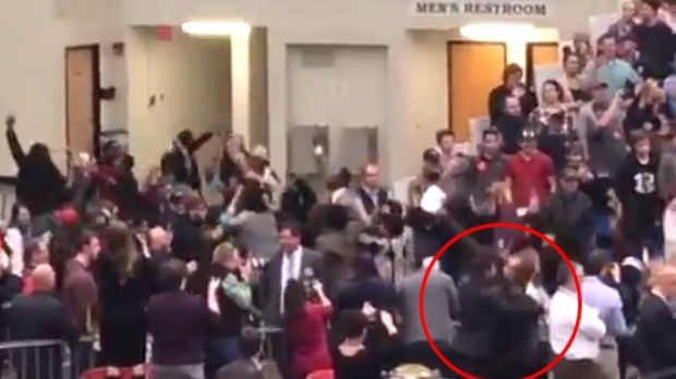 Chris Morris and the Secret Service agent in the bottom-right of the frame.