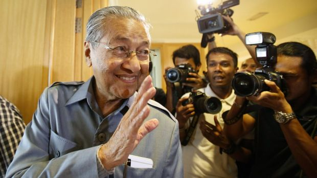 Former Malaysian prime minister Mahathir Mohamad waves to photographers after a press conference in Putrajaya on Monday.