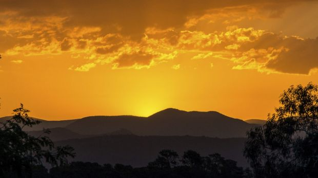 The sun setting behind the Brindabellas. South Canberra residents may also see smoke over there as a hazard reduction ...