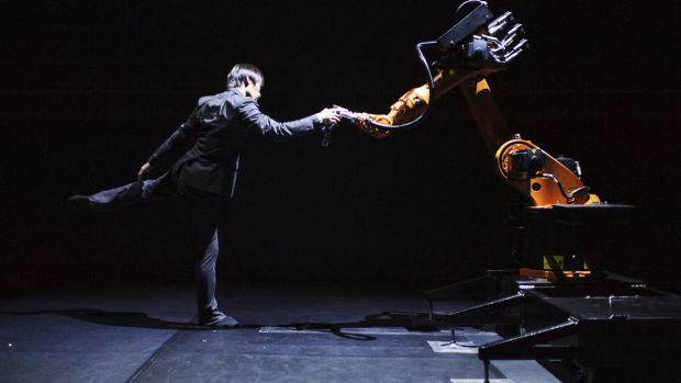 Taiwanese dancer and choreographer Huang Yi  performs a duet with KUKA the robot.