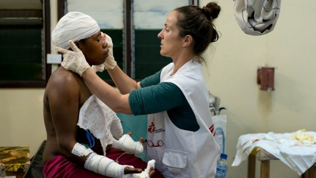 Irish nurse Aoife Ni Mhurchu treats a patient last year at Tari Hospital in the highlands region of Papua New Guinea. ...