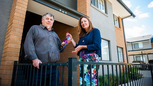 Treasurer of ECHO Peter Sutherland gets the keys from Housing Minister Yvette Berry.
