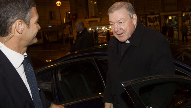 Australian Cardinal George Pell, right, arrives on Monday at the Quirinale hotel in Rome to testify via videolink to the ...