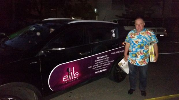 Robert Green with the car Elite Strippers are advertising on the side of which is used for Uber.