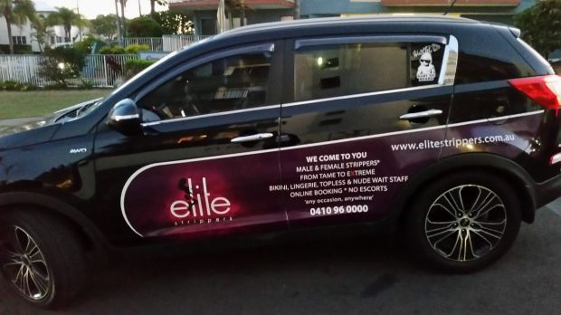 Elite Strippers are advertising on the side of a car used for Uber