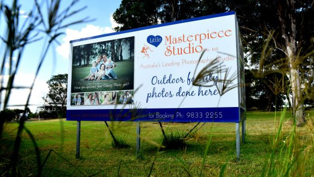 Advertising boards along the Great Western Highway, on the lawn of a residential property in Rooty Hill, the current ...