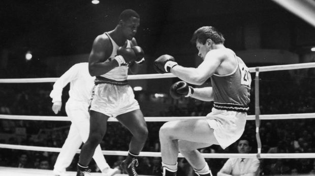 American boxer Joe Frazier fells his Soviet opponent Vadim Yemelyanov in the Olympic Super Heavyweight Boxing semi-final ...