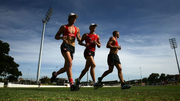Ted Richards and Sam Reid warm up during a Sydney Swans training session at Drummoyne Oval on Wednesday.