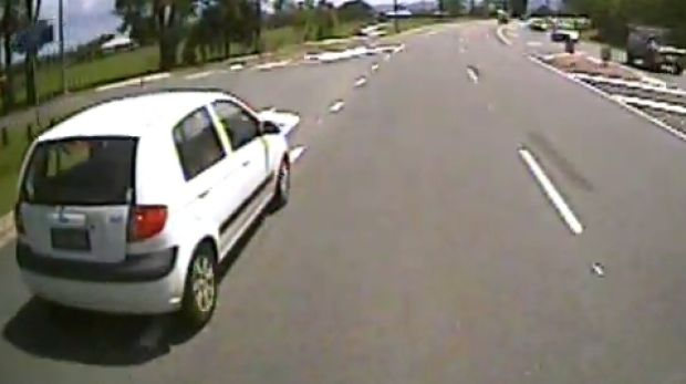The alleged attacker was driving in front of the truck in a white hatchback.