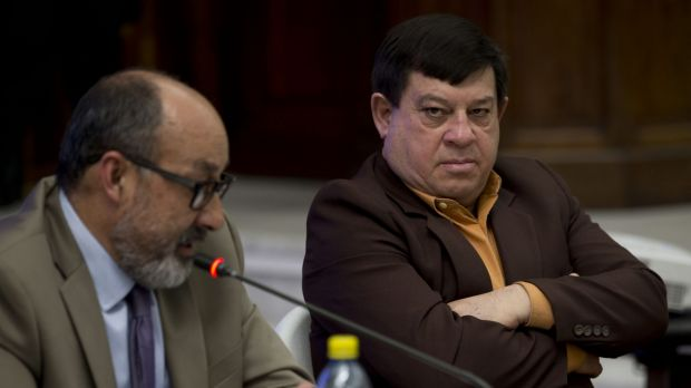 Former army officer Esteelmer Francisco Reyes Giron, right, listens to his lawyer Moises Galindo during the trial ...