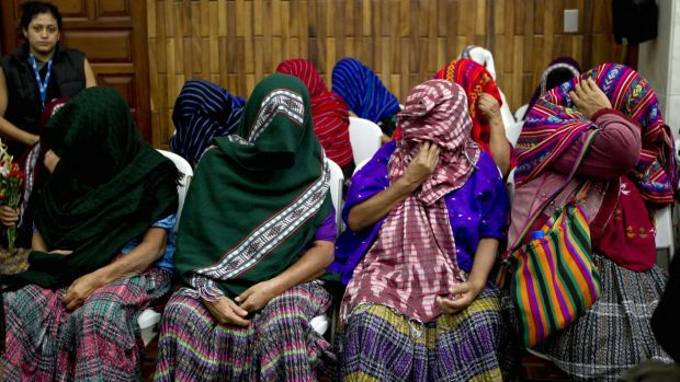Victims of sexual violence hide their faces during the trial against former military officer and a former paramilitary ...