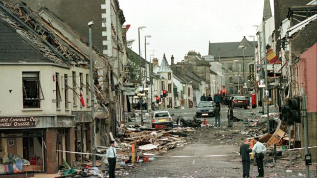Royal Ulster Constabulary Police officers at the scene of a car bombing in the centre of Omagh, 115km west of Belfast, ...