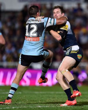 Tough loss: Wade Graham tries to tackle Michael Morgan during the NRL semi-final between the North Queensland Cowboys ...
