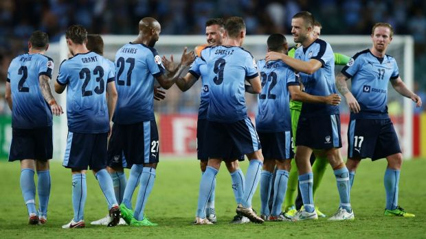 Job well done:  Sydney FC players celebrate their win over Guangzhou in the Asian Champions League at Allianz Stadium.