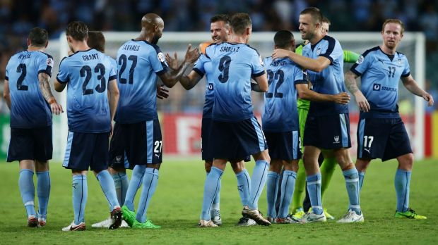 Up and down season: Sydney FC players celebrate their win over Guangzhou in the Asian Champions League at Allianz ...