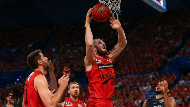 Jesse Wagstaff of the Wildcats gathers a rebound during game one of the NBL Grand Final series against the New Zealand ...