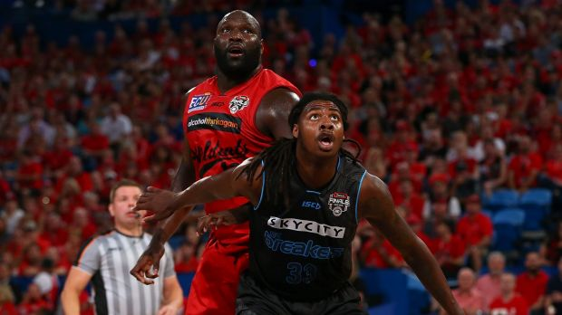 Nate Jawai of the Wildcats and Charles Jackson of the Breakers have eyes only for the ball.