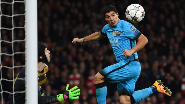 Close one: Luis Suarez of Barcelona directs a header at the goal of Petr Cech of Arsenal.